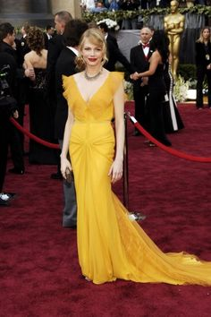 "In a mustard-yellow Vera Wang gown, Michelle Williams showed off a high-wattage look that had none of the gimmicky trappings of previous red carpet ""best-dressed"" moments. In a vintage cut, an unusual color, simple accessories, and a casual updo, Michelle was the picture of a modern-day fairy-tale princess."