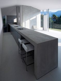 Another view of the table-kitchen-wall element inside the F House by Kubota Architect Atelier.