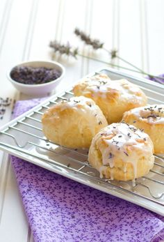 Lavender Cream Biscuits 4 cups all purpose flour 2 tablespoons sugar 1 1/2 tablespoon baking powder 1 tablespoon kosher salt 1/2 cup cubed, chilled butter 1 1/2 cup heavy cream (a little more may be needed) Lavender Glaze 1/2 cup milk 1 tablespoon dried lavender buds 1 cup powdered sugar