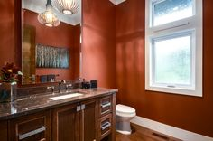 Burnt Orange Paint Color Powder Room Transitional with Brown Countertop Dark Wood