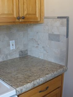 New Backsplash And Granite Counter Tops