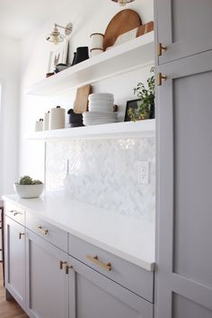 """Our DIY shaker doors painted to complete this """"Small but Perfectly Formed Miami Beach Kitchen."""" Courtesy of Habitat Collective / Rolando Diaz Home Decor Kitchen, Kitchen Interior, Kitchen Design, Kitchen Ideas, Rustic Kitchen, Small Condo Kitchen, Ikea Kitchen, Kitchen Pantry, Beach Kitchens"""