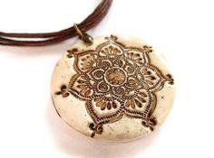 Lotus mandala pendant, faux ivory, aged bone necklace, yoga jewelry. $18.00, via Etsy.