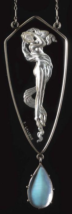 Lalique 1906 Pendant Figurine & Moonstone: plaque w/erotic nude female motif is clear glass w/a moonstone drop