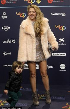 Mummy's boy: The superstar held the hand of her adorable little boy