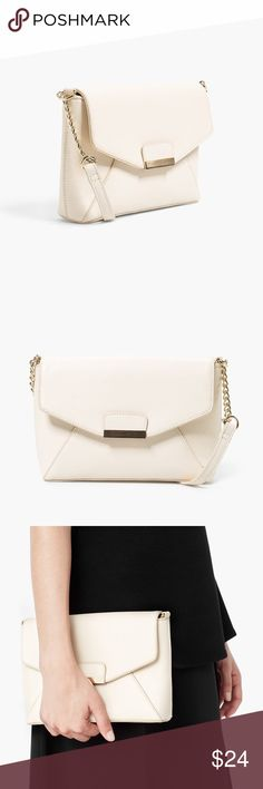 """Mango Metal Appliqué Shoulder Bag New without tags. Ivory textured faux Saffiano leather with gold toned detailing. Flap has a magnetic closure. 8.5"""" wide x 6"""" tall x 2"""" deep. Adjustable strap with a max drop of 21"""". Mango Bags Shoulder Bags"""