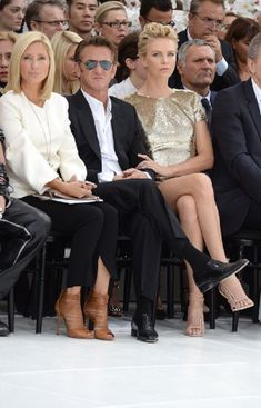 (L-R) Marie-Chantal, Crown Princess of Greece, Sean Penn and Charlize Theron attend the Christian Dior show of Paris Fashion Week - Haute Couture Fall/Winter 2014-2015 on 07.07.2014 in Paris, France.