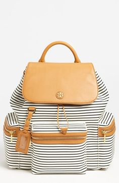 Slim stripes lend a crisp nautical air to a snappy canvas backpack trimmed in rich, smooth leather. A shining logo medallion lends signature grace to the flap, while a trio of exterior zip pockets provides ample storage space for necessities. Color(s): black/ vanilla cake, tory navy stripe. Brand: Tory Burch. [...]