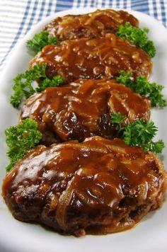 Great tasting salsbury steaks w a side of garlic mashed potatoes ... yum o
