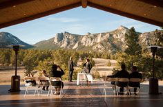 The groom waits for his bride at Black Canyon Inn (Estes Park, Colorado) with views of Rocky Mountain National Park. AutumnCutaia06