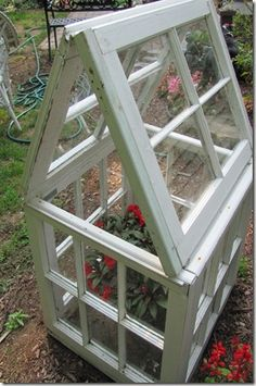 Small greenhouse made from old windows - I love this lady's stuff!
