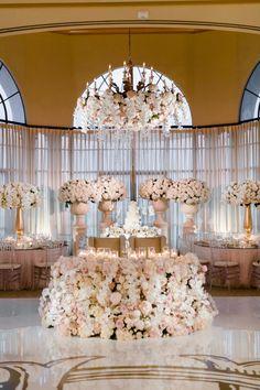 Wedding venue covered in florals! http://www.stylemepretty.com/california-weddings/newport-beach/2016/10/06/soft-pastel-newport-wedding/ Photography: The De Juareguis - http://www.thedejaureguis.com/