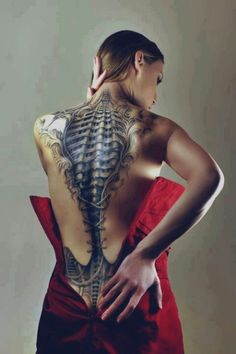 Beautiful back piece biomechanical tattoo off a woman. #TattooModels #tattoo