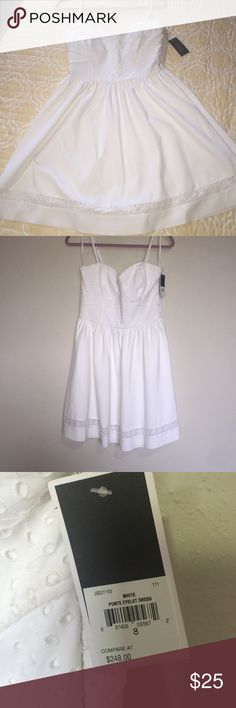 NWT White Juicy Couture Eyelet Dress NWT Juicy Summer dress, size 8, has never been worn. Has some dust from sitting in storage, as you can see in last picture, but nothing that won't go away with a wash. I bought it when I was a few sizes bigger, now it no longer fits me. Make me an offer! Juicy Couture Dresses Midi