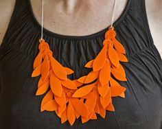 Yes, it's my second big orange necklace in as many days, but honestly, this was my favorite of all the colors in this style. Love the shapes, the sense of movement, the delicate chain balancing the bold leaves, and the bright orange color!