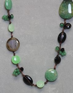 "Awesome Gemstone Necklace ;-) Another beauty.... what can we say - we LOVE beautiful jewelry! 36"" of fabulousness, this Gemstone Necklace is beaded with Carneline Agate, Jade and Onyx. $35"