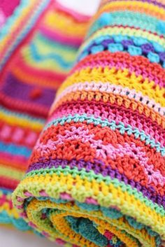 As-We-Go Stripey Blanket crocheted by Ingrid de Vries from a pattern inspired by Julie Harrison and designed by Hannah Davis (Owens) of NotYourAverageCrochet Free pattern here:  https://notyouraveragecrochet.com/as-we-go-stripey-blanket/