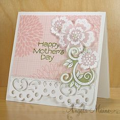 handmade Mothers Day Card by Angela Maine ... luv the white embossing on pink and green vellum for the arrangement of flowers in the corners ... some zig zag sewing  .... Hero Arts ...