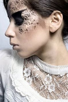 lace make up, i rember trying this out for a costume party myself with golden shimmery powder it looked stunning.