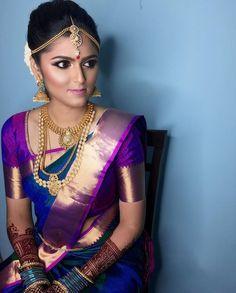 South Indian bride. Gold Indian bridal jewelry.Temple jewelry. Jhumkis.Purple silk kanchipuram sari.Braid with fresh jasmine flowers. Tamil bride. Telugu bride. Kannada bride. Hindu bride. Malayalee bride.Kerala bride.South Indian wedding.