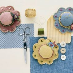 Wool Pincushions @BHG: Old-fashioned hats are the inspiration for these spring-themed pincushions. Flowers and beads bedazzle the cute country hats. The appliqued flowers don't require much fabric~scraps you have on hand work perfectly.