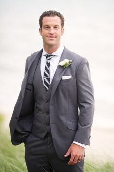 #Groom #Gray Suit #SMP Weddings: http://www.stylemepretty.com/2013/12/04/michigan-backyard-beach-wedding-from-kelly-sweet-photography | Kelly Sweet Photography