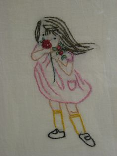 Girl smelling flowers embroidery  (avg)