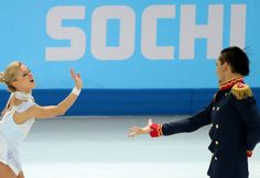 epa04070065 Tatiana Volosozhar and Maxim Trankov of Russia perform during the Pairs Short Program of the Figure Skating event at Iceberg Pal...