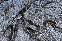 Description Textured fabric of woven 'twigs' in antique/sage gold.