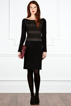 A gorgeous knitted dress with intricate stitch detail featuring horizontal ribbing and pretty cut out polka dot detail exposing contrasting nude lining. The Kitty Knit dress features a wide neckline to flatter your hips and hugs your curves to emphasise your waist. The full length sleeves make this dress the ideal winter outfit with unrivalled style and ease. Comfortable to wear the dress is fully lined for effortless wearing.