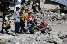 Palestinian children play on a street in Gaza's northern district of Beit Hanun during the Muslim holiday of Eid al-Adha, Oct. 4, 2014.