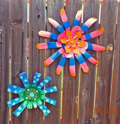 Flowers made from upcycled plastic planter pots for my granddaughter's play area...