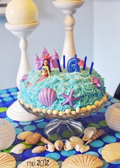 """mermaid cake. easy peasy. decorations from the dollar store, white """"rocks""""- yogurt raisins, white candy pearls. My 6 yr old was a happy girl :)"""