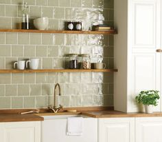 tiles Backsplash Green tiles are the perfect accessory to a country farmhouse kitchen. These 'Mere' tiles from The Winchester Tile Company are a subtle nod to the green tile trend and look gorgeous when paired with natural woods and foliage. Kitchen Wall Tiles Design, Country Kitchen Tiles, Green Kitchen Walls, Country Kitchen Designs, Farmhouse Style Kitchen, Modern Farmhouse Kitchens, Country Farmhouse, Kitchen Modern, Tile Design