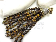 1 pc Agate Beaded Bombastic Tassel with Antique Bronze Ornate Tassel Cap, Tassel Pendant  Approx. Lenght 93mm, Cap Diameter 15mm, Stones 4mm  Matte Antique Bronze Tone Metal Alloy with Crystal Rhinestones and Agate Beads  FOR MORE GEMSTONE TASSELS https://www.etsy.com/shop/turkisheyesupply/search?search_query=gemstone+tassel&order=date_desc&view_type=list&ref=shop_search  Lead and Nickel safe/free  *All Tassel caps are hand made and there can be inperfections on the layout of stones…