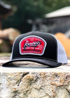 Logo: Embroidered Patch Material: Cotton/poly-twill front panels, Trucker mesh back Closure: Plastic snap adjustable Sizes: Adult | One size fits most Patches, Baseball Hats, Embroidered Patch, A3, Black, Mesh, Plastic, Closure, Logo