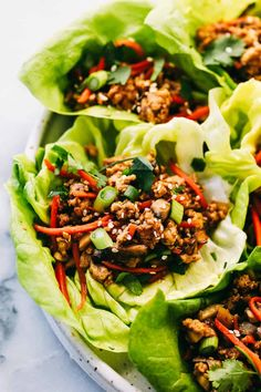Asian Turkey Lettuce Wraps My vegan Asian Slaw with a creamy. - Asian Turkey Lettuce Wraps My vegan Asian Slaw with a creamy peanut dressing is a Chinese coleslaw with chow mein noddles that tastes so good you don't even realize how healthy it is. Ground Turkey Lettuce Wraps, Asian Lettuce Wraps, Lettuce Wrap Recipes, Turkey Wraps, Healthy Lettuce Wraps, Thai Chicken Lettuce Wraps, Coleslaw Sauce, Asian Coleslaw, Coleslaw Dressing