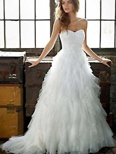 Gorgeous Strapless Tulle Ruffle Ball Gown, Galina  Photo: Courtesy of David's Bridal