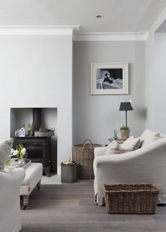 Example of a danish enclosed dark wood floor and brown floor living room design in Dublin with white walls and a metal fireplace 1930s Living Room, Cottage Living Rooms, Living Room White, Home Living Room, Interior Design Living Room, Living Room Designs, Long Island, Sofas, Snug Room
