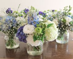 Pretty soft blue hydrangea, sweet lisianthus and cute button chrsanthemum in vintage jars