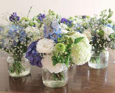 Pretty soft blue hydrangea, sweet lisianthus and cute button chrsanthemum in vintage jars