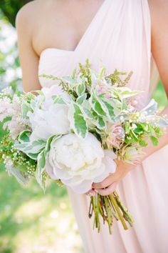 Full and lovely bridesmaid bouquet: http://www.stylemepretty.com/minnesota-weddings/2015/03/09/traditionally-elegant-nicollet-island-wedding/ | Photography: Erica Loeks - http://ericaloeks.com/