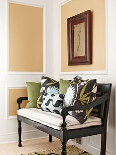 Piled with pillows and resting at just the right height to highlight the gorgeous wall paneling, this cushioned bench isn't so much practical as pretty: It gives visitors a taste of the home's decor upon stepping in the door.