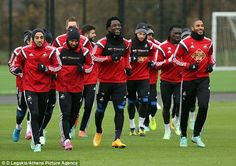 Star striker Wilfried Bony (centre) smiles as he leads his side around the Fairwood Training Ground