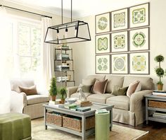 Example of how a collection of art prints uses all the vertical space behind a sofa