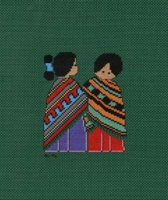 Desert Maidens, design by Meredith Mark (1991).  I cross stitched this on vinyl-weave 14 count cross stitch fabric for a 3 ring binder cover.