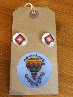 Cross stitch cufflinks under glass cabuchons