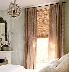 Simple panels with a fine vertical stripe against bamboo blinds with a horizontal aesthetic.