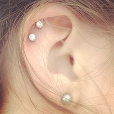 Cartilage double ear piercing. I am so doing this and using my kids birth stones.