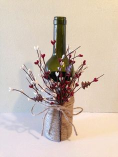 Wine decor, twine wine bottles, wine bottles, decorated wine bottles but spray the bottles with gold Twine Wine Bottles, Wine Bottle Corks, Wine Bottle Crafts, Bottles And Jars, Jar Crafts, Centerpieces With Wine Bottles, Wine Bottle Decorations, Wine Bottle Christmas Decor, Diy With Glass Bottles